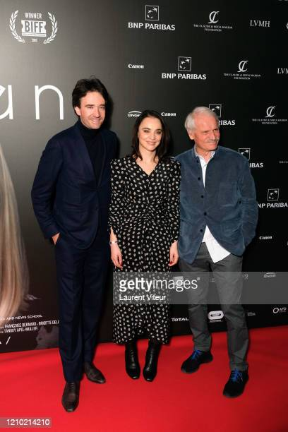 Antoine Arnault Anastasia Mikova and Yann ArthusBertrand attend the Woman Premiere At UGC Normandie on March 03 2020 in Paris France