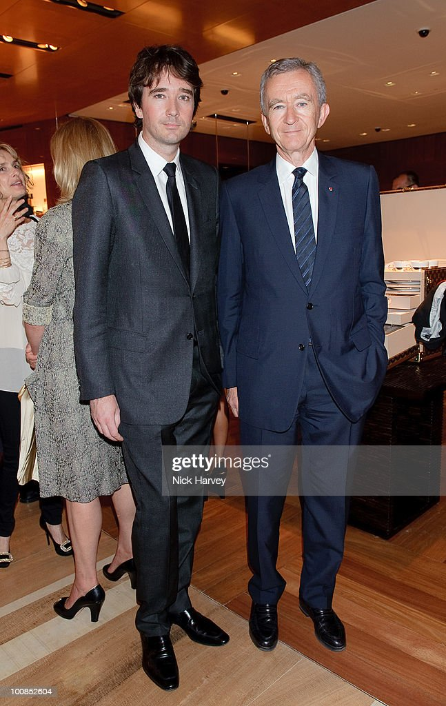 Antoine Arnault (L) and Bernard Arnault attend the launch of the Louis Vuitton Bond Street Maison on May 25, 2010 in London, England.
