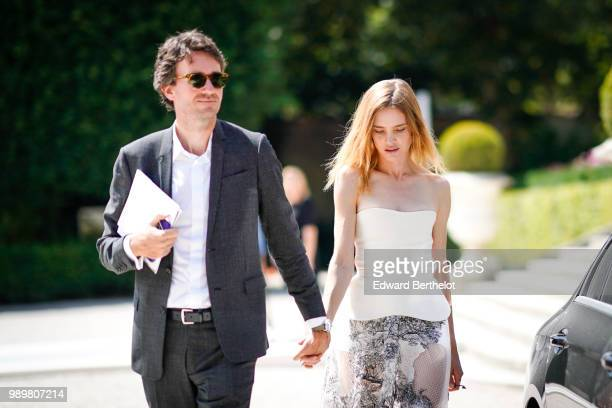 Antoine Arnault and Natalia Vodianova outside the Dior show during Paris Fashion Week Haute Couture Fall Winter 2018/2019 on July 2 2018 in Paris...