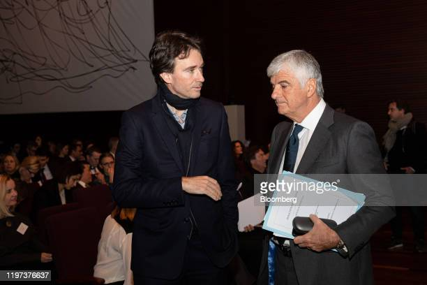 Antoine Arnault chief executive officer of Berluti SA left speaks to Antonio Belloni chief executive officer of Fendi International SA as LVMH Moet...