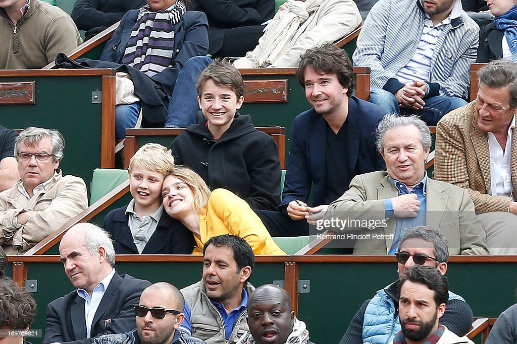 Antoine Arnault (behind R), his brother Jean Arnault (behind L), his companion Natalia Vodianova (front L) and her son attend Roland Garros Tennis French Open 2013 - Day 7 on June 1, 2013 in Paris, France.