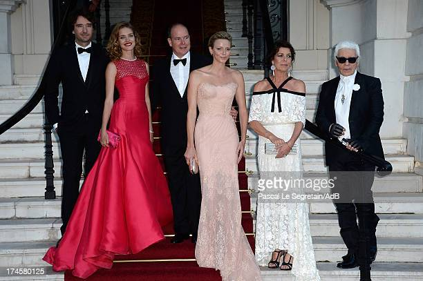 Antoine Arnault Natalia Vodianova Prince Albert II of Monaco Princess Charlene of Monaco Princess Caroline of Hanover and Karl Lagerfeld arrive at...