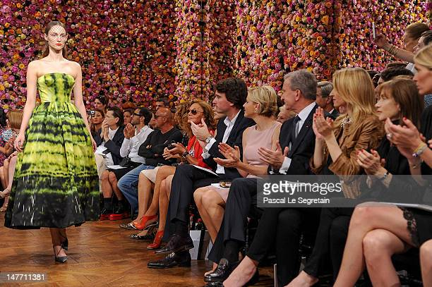 Antoine Arnault Princess Charlene Bernard Arnault Delphine Arnault and Isabelle Huppert applaud as a model walks the runway the Christian Dior...