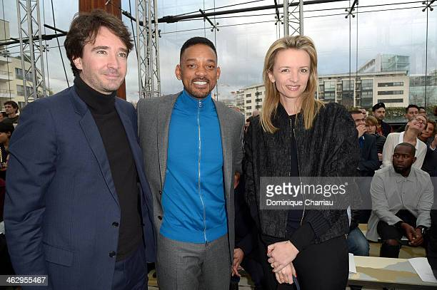 Antoine Arnault, Will Smith and Delphine Arnault attend the Louis Vuitton Menswear Fall/Winter 2014-2015 Show as part of Paris Fashion Week on...