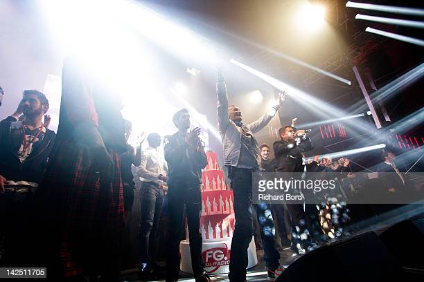 Antoine Baduel and guests celebrate onstage during the Radio FG 20th Anniversary Celebration at Le Grand Palais on April 5 2012 in Paris France
