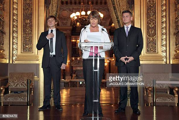 Antoine Baduel head of the FG Dj radio and French musician Martin Solveig listen to France's Minister for Culture and Communication Christine Albanel...