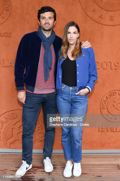 Antoine Benneteau and his companion Charlotte Gabris attend the 2019 French Tennis Open Day Eleven at Roland Garros on June 05 2019 in Paris France