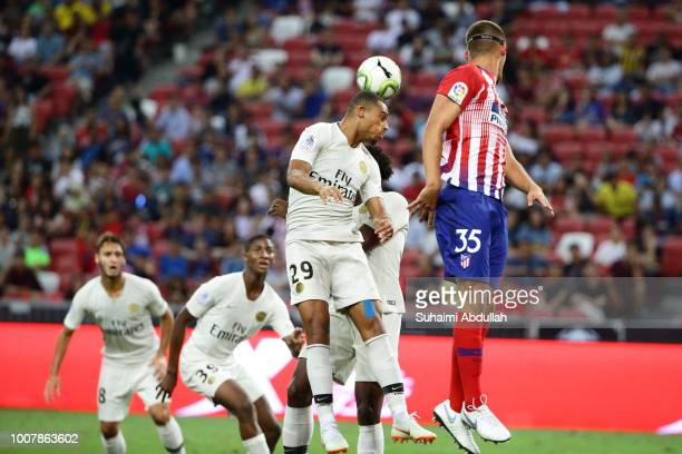 Antoine Bernede of Paris Saint Germain and Francisco Montero of Atletico Madrid jump for the ball during the International Champions Cup 2018 match...