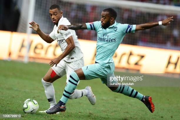 Antoine Bernede of Paris Saint Germain challenges Alexandre Lacazette of Arsenal for the ball during the International Champions Cup match between...