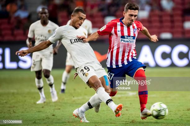 Antoine Bernede of Paris Saint Germain fights for the ball with Joaquin Munoz of Club Atletico de Madrid during the International Champions Cup 2018...
