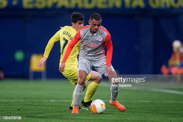 Antoine Bernede of RB Salzburg controls the ball under pressure from Gerard Moreno of Villarreal CF during the UEFA Europa League Round of 32 second...
