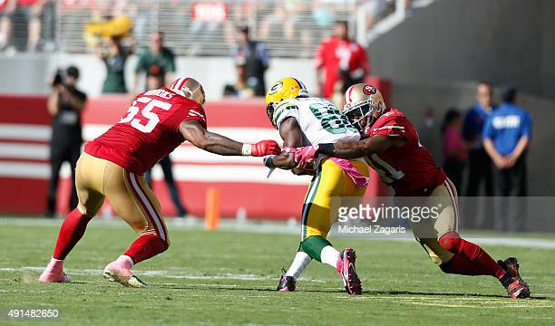 Antoine Bethea and Ahmad Brooks of the San Francisco 49ers tackle Ty Montgomery of the Green Bay Packers during the game at Levi Stadium on October 4...