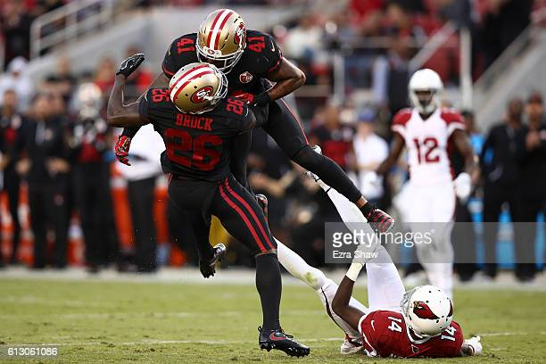 Antoine Bethea hits Tramaine Brock of the San Francisco 49ers while going after a tipped ball against the Arizona Cardinals during their NFL game at...