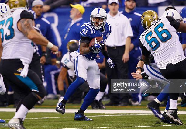 Antoine Bethea of the Indianapolis Colts runs the ball after an interception against the Jacksonville Jaguars at Lucas Oil Stadium on December 29...