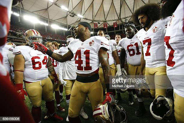 Antoine Bethea of the San Francisco 49ers fires the team up on the field prior to the game against the Atlanta Falcons at the Georgia Dome on...