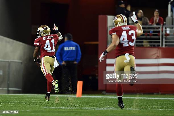 Antoine Bethea of the San Francisco 49ers runs back an interception for a touchdown as Craig Dahl celebrates behind him in the second quarter against...