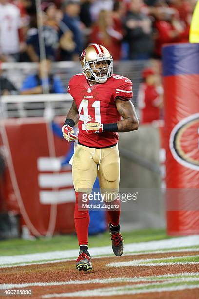 Antoine Bethea of the San Francisco 49ers stands in the end zone after scoring on an interception return during the game against the San Diego...