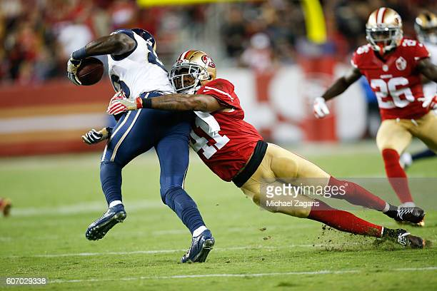 Antoine Bethea of the San Francisco 49ers tackles Brian Quick of the Los Angeles Rams during the game at Levi Stadium on September 12 2016 in Santa...