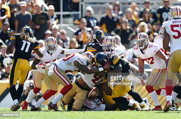 Antoine Bethea of the San Francisco 49ers tackles DeAngelo Williams of the Pittsburgh Steelers during the game at Heinz Field on September 20 2015 in...