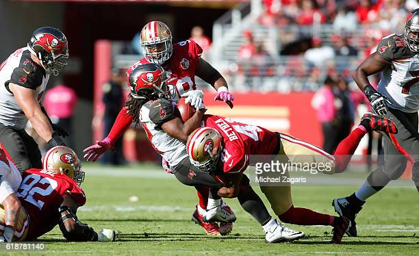 Antoine Bethea of the San Francisco 49ers tackles Jacquizz Rodgers of the Tampa Bay Buccaneers during the game at Levi Stadium on October 23 2016 in...