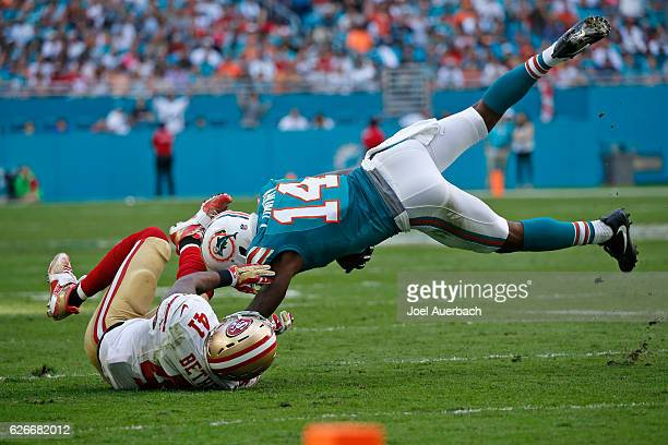 Antoine Bethea of the San Francisco 49ers tackles Jarvis Landry of the Miami Dolphins on November 27 2016 at Hard Rock Stadium in Miami Gardens...