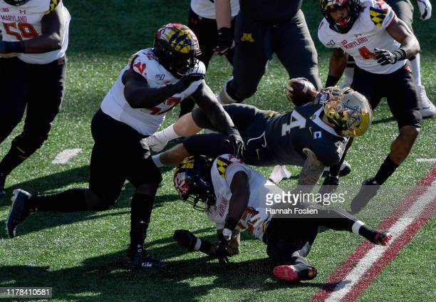 Antoine Brooks Jr #25 of the Maryland Terrapins tackles Shannon Brooks of the Minnesota Gophers during the first quarter of the game at TCF Bank...
