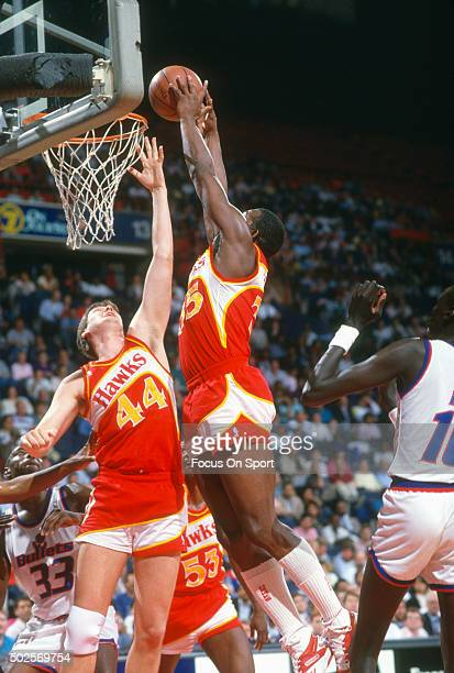 Antoine Carr of the Atlanta Hawks goes up for a slam dunk against the Washington Bullets during an NBA basketball game circa 1988 at the Capital...