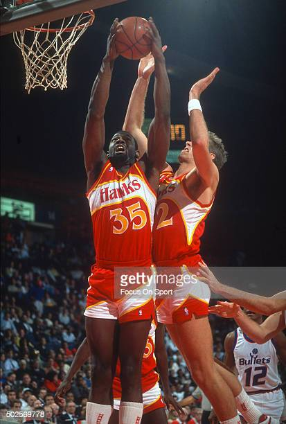 Antoine Carr of the Atlanta Hawks grabs a rebound against the Washington Bullets during an NBA basketball game circa 1988 at the Capital Centre in...