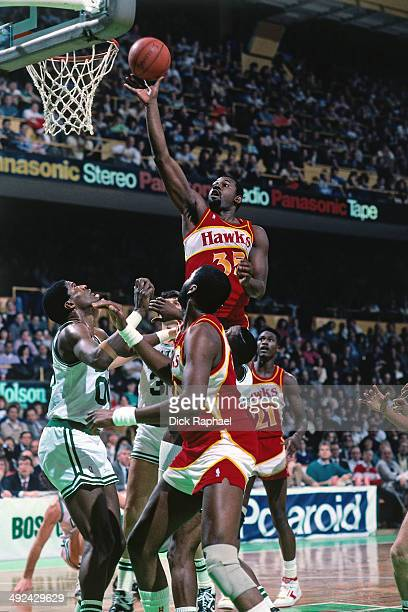 Antoine Carr of the Atlanta Hawks shoots against the Boston Celtics during a game played in 1988 at the Boston Garden in Boston Massachusetts NOTE TO...