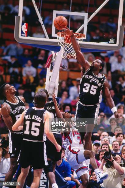 Antoine Carr of the San Antonio Spurs blocks a shot attempt against the New Jersey Nets during a game played circa 1993 at the Brendan Byrne Arena in...