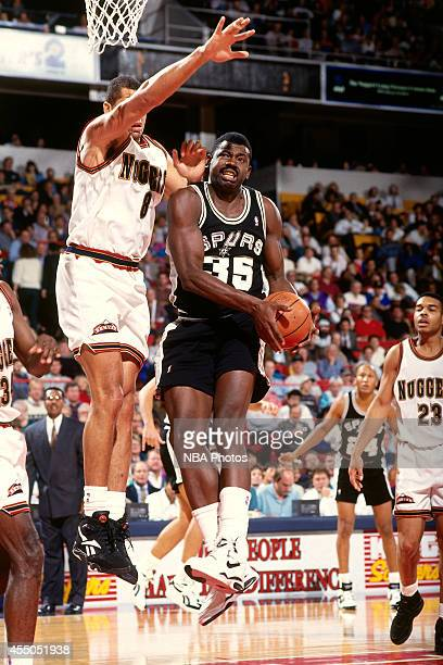 Antoine Carr of the San Antonio Spurs shoots against the Denver Nuggets circa 1994 at the McNichols Sports Arena in Denver Colorado NOTE TO USER User...