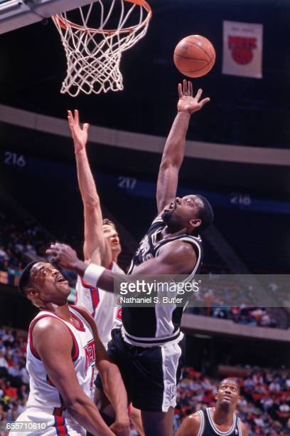 Antoine Carr of the San Antonio Spurs shoots against the New Jersey Nets circa 1993 at the Contintental Airlines Arena in East Rutherford New Jersey...