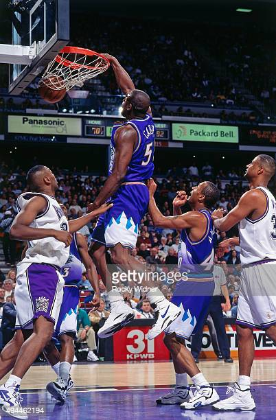 Antoine Carr of the Utah Jazz dunks against the Sacramento Kings circa 1997 at Arco Arena in Sacramento California NOTE TO USER User expressly...