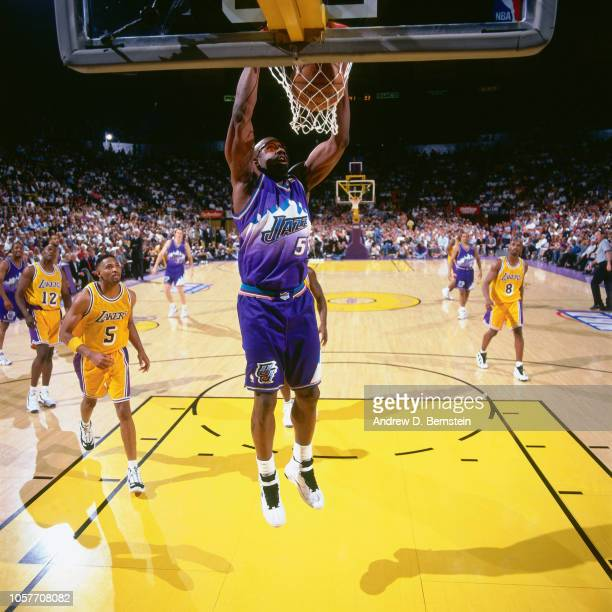Antoine Carr of the Utah Jazz dunks during Game Three of the Western Conference Semifinals as part of the 1997 NBA Playoffs on May 8 1997 at the...