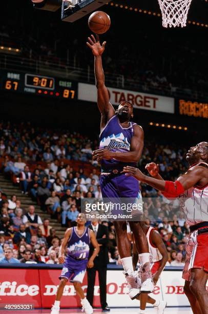 Antoine Carr of the Utah Jazz puts a shot up during the game against the Houston Rockets on January 10 1998 at the Compaq Center in Houston Texas The...