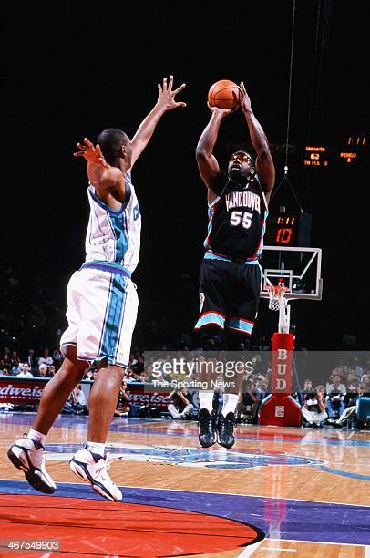 Antoine Carr of the Vancouver Grizzlies takes a jump shot against the Charlotte Hornets on November 24 1999 at Charlotte Coliseum in Charlotte North...
