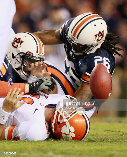 Antoine Carter and Mike McNeil of the Auburn Tigers tackle quarterback Kyle Parker of the Clemson Tigers at JordanHare Stadium on September 18 2010...