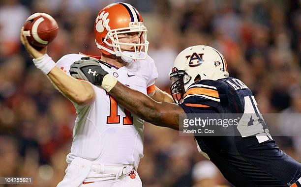 Antoine Carter of the Auburn Tigers pressures quarterback Kyle Parker of the Clemson Tigers at JordanHare Stadium on September 18 2010 in Auburn...