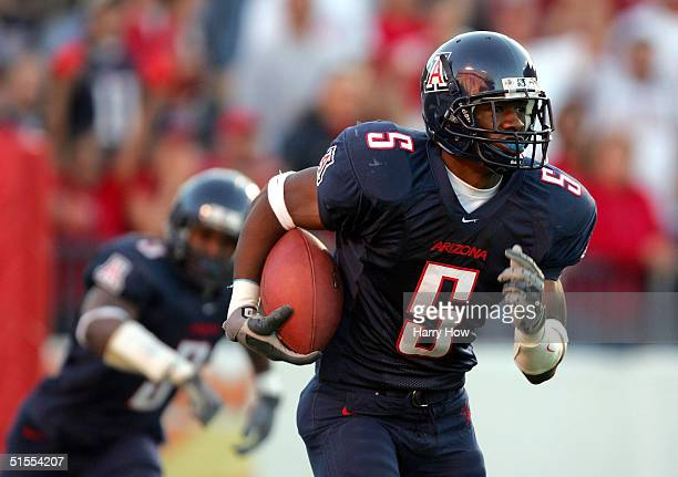 Antoine Cason of Arizona makes an interception off of a deflection by Wilrey Fontenot in the second quarter at Arizona Stadium on October 23, 2004 in...