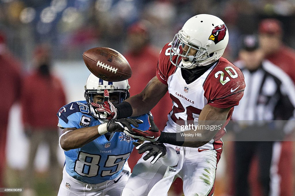 Antoine Cason #20 of the Arizona Cardinals intercepts a pass and scores a touchdown thrown to Nate Washington #85 of the Tennessee Titans at LP Field on December 15, 2013 in Nashville, Tennessee. The Cardinals defeated the Titans 37-34.
