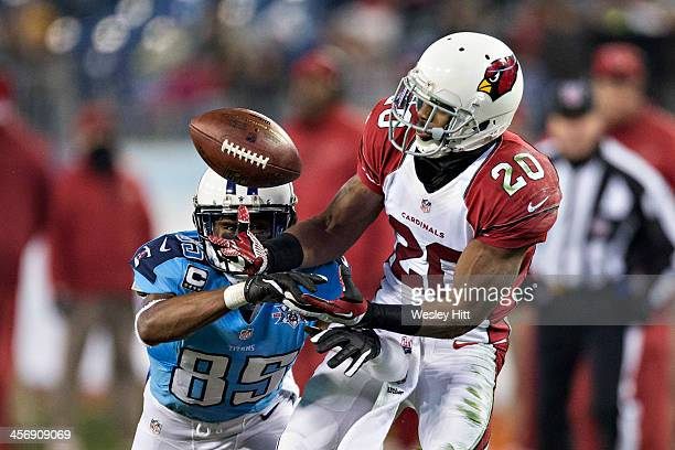 Antoine Cason of the Arizona Cardinals intercepts a pass and scores a touchdown thrown to Nate Washington of the Tennessee Titans at LP Field on...