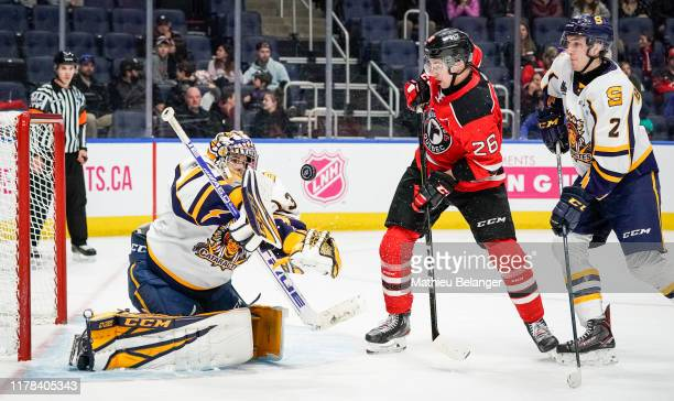 Antoine Coulombe of the Shawinigan Cataractes makes a save against the Quebec Remparts during their QMJHL hockey game at the Videotron Center on...