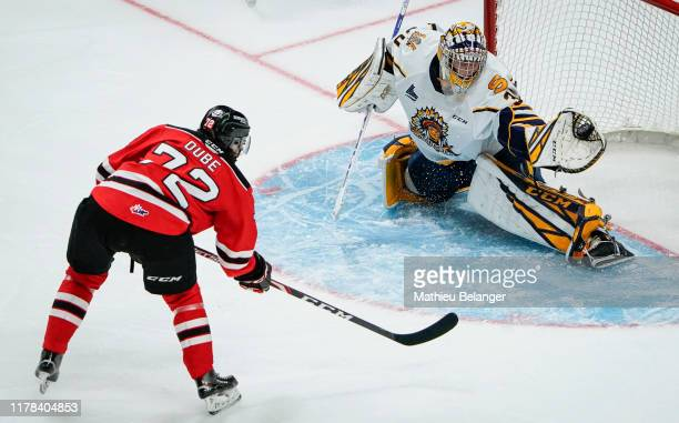 Antoine Coulombe of the Shawinigan Cataractes makes a save on Pierrick Dube of the Quebec Remparts during their QMJHL hockey game at the Videotron...
