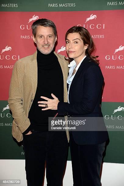 Antoine De Caunes and Daphne Roulier attend day 4 of the Gucci Paris Masters 2013 at Paris Nord Villepinte on December 8 2013 in Paris France