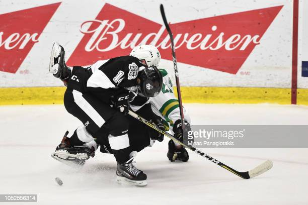 Antoine Demers of the BlainvilleBoisbriand Armada and Maxence Guenette of the ValdOr Foreurs fall to the ice during the QMJHL game at Centre...