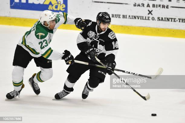 Antoine Demers of the BlainvilleBoisbriand Armada skates the puck against Anthony Allepot of the ValdOr Foreurs during the QMJHL game at Centre...