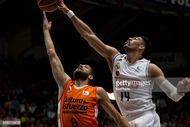Antoine Diot and 14 Gustavo Ayon of Real Madrid Basket during Endesa league basketball in fourth semifinals match between Valencia Basket and Real...