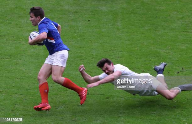 Antoine Dupont of France in action with George Furbank of England during the 2020 Guinness Six Nations match between France and England at Stade de...