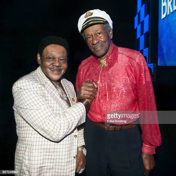 Antoine 'Fats' Domino and Chuck Berry pose for a photo backstage at The Domino Effect concert at New Orleans Arena on May 30 2009 in New Orleans...