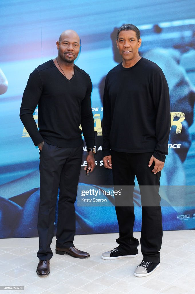 Antoine Fuqua and Denzel Washington attend the 'Equalizer' Paris Photocall at Hotel Bristol on September 15, 2014 in Paris, France.